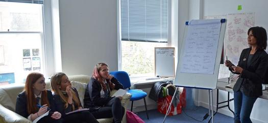 Eryl Shields leads a discussion at a Brave New Words spoken word writing workshop