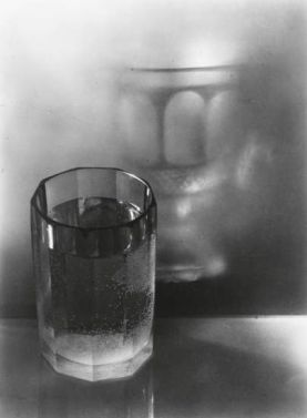 I love this photograph of Josef Sudek, it's apparently a water filled glass reflected in a misted window, but the reflected glass looks quite different to its parent.